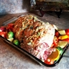 Juicy boneless leg of lamb with roasted vegetables