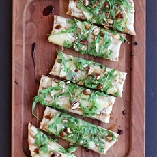 Grilled Flatbread with Brie, Arugula, Candied Nuts, and Balsamic-Honey