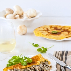 Chickpea flour crepes with a creamy mushroom filling