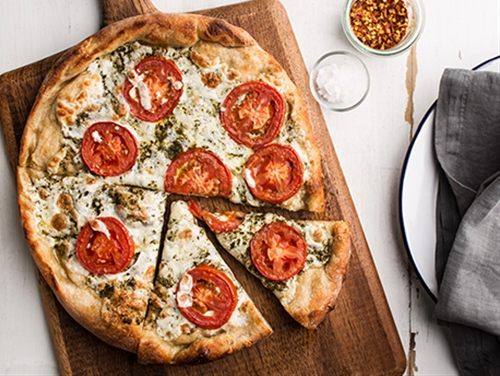 Pizza with Pesto, Fresh Tomatoes, and Mozzarella
