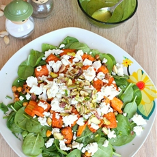 Baby spinach salad with roasted carrots, feta & pistachios