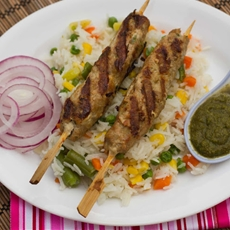 Seekh Kebabs (Minced Lamb Kebabs) on a bed of Vege Rice