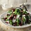 Broccoli salad with raisins, pumpkin seeds and yoghurt sauce