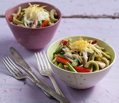 Stir fry vegetables with swivels, cheese and lemon zest