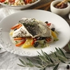 Fish fillet with fennel root salad and olive oil and citrus fruit dres