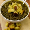 Lentil and green pea soup with bread croutons