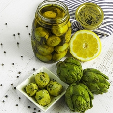 homemade preserved baby artichokes in oil