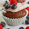 Chocolate fudge muffin with blueberries whipped cream