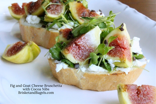 FIG AND GOAT CHEESE BRUSCHETTA WITH COCOA NIBS, ORANGE AND ARUGULA