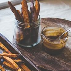 Turmeric Baked Sweet Potato Wedges with Smoky Tahini Dip