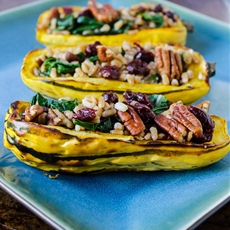 Farro Stuffed Delicata Squash with Pecans, Cranberries, and Kale