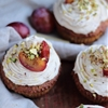 Plum and pistachio muffins with mascarpone frosting