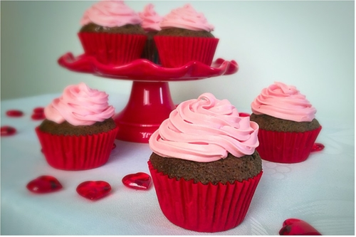 Pink frosting chocolate cupcakes