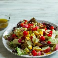 Apple walnut zucchini salad with black plum vinaigrette dressing