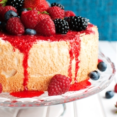 Perfect Angel Food Cake with Raspberry Sauce and Berries