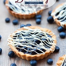 Blueberry Tartlets with White Chocolate Drizzle