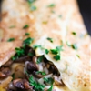 Omelet with mushrooms, onions and mozzarella