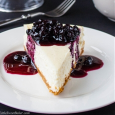 Low-Fat Vanilla Bean Cheesecake with Blueberry Compote