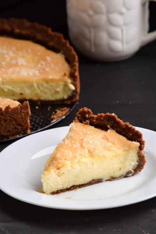 Salted Caramel Vanilla Bean Cheesecake with Gingerbread Crumb Crust