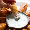 Baked Mini Buffalo Chicken Egg Rolls with Blue Cheese Sauce