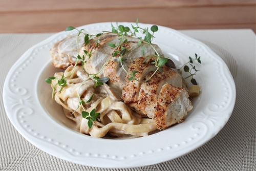 Fresh Pasta In A Mushroom Sauce Topped With Chicken Breast