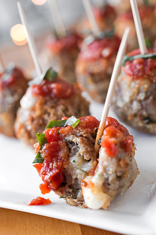Crispy Caprese Meatballs Stuffed with Fresh Mozzarella, topped with Ma