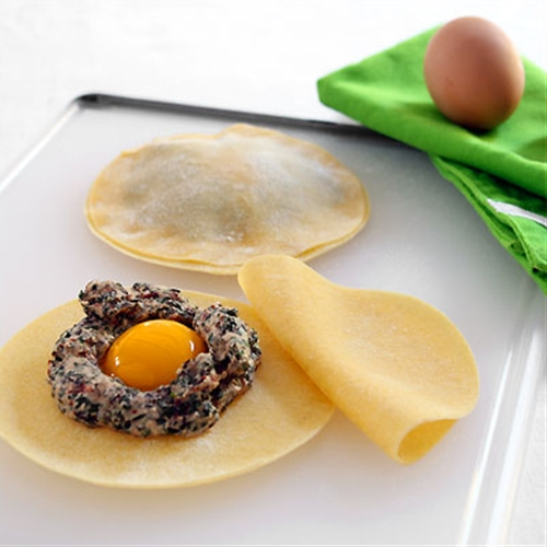Raviolo with Egg Yolk in Truffle Scented Sage Brown Butter Sauce