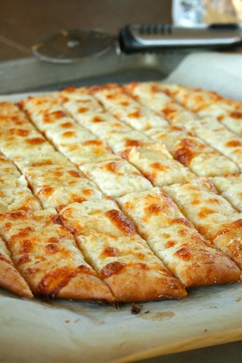 Fail-Proof Pizza Dough and Cheesy Garlic Bread Sticks recipe ...