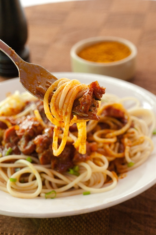 Spaghetti with currywurst sauce