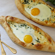 kale khachapuri (egg and cheese bread)