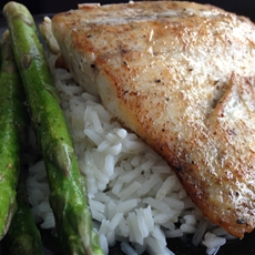 Spicy garlic pan seared sea bass with asparagus